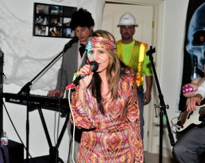 Donna singing, 60's party